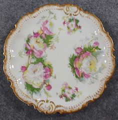 Item Description Shipping Info Payment Info Limoges Coronet Ceramic 7 1/2 Plate w/ Pink Roses & Gold Accent, France Mouse over Thumbnails To Enlarge Limoges Coronet Plate Size: 7 1/2 diameter Ceram