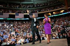 Barack and Michelle Obama greet the crowd