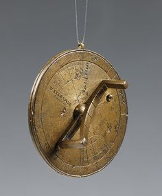 Portable vertical sundial, ca. 250 A.D. Oxford, Museum of the History of Science, inv. 51358  Portable sundial calibrated for a variety of latitudes. The curved piece rotating above the smaller disc is a combination between an hour-scale and a gnomon, to indicate the date. Suspended in the vertical plane, it marked the hour. The back of the larger disc carries the latitudes of 30 provinces in the Roman Empire.