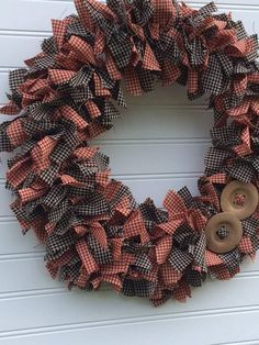 Adorable rustic and primitive rag wreath will be a great addition to your decor. Measures approximately 16 in in diameter, full with black and red checkered fabrics. Cute as a button with button embellishments ! Wreaths make a beautiful statement indoors and out. Wreaths will keep better Fabric Wreath, Diy Wreath, Burlap Wreath, Wreath Making, Wreath Ideas, Primitive Wreath, Easy Primitive Crafts, Primitive Country, Wreaths For Front Door
