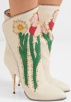 fe1b82859fc18 These GUCCI Fosca appliquéd embellished textured-leather ankle boots are  made from cream textured-