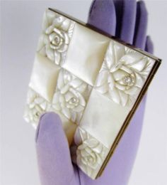 Most elegant way to carry cash and credit cards for evening! #Schildkraut #MotherofPearl carved roses on vintage cigarette case. www.Connectibles.net