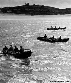Inis Oirr Aran island, O'Briens castle & currach boats at dusk
