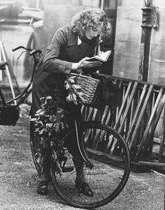 """Vanessa Redgrave reading on bicycle, 1977. Redgrave won an Academy Award for Best Supporting Actress in Julia (1977) based on Lillian Hellman's book Pentimento, a chapter of which purports to tell the story of her relationship with a lifelong friend, """"Julia,"""" who fought against the Nazis in the years prior to World War II."""