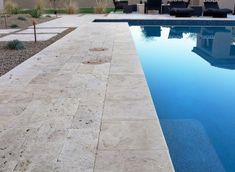 i like the travertine around the pool but is it slippery when wet