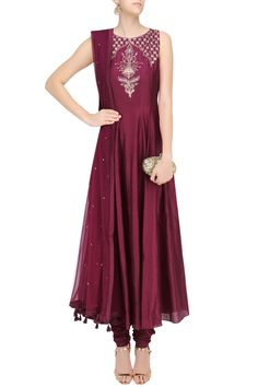 Description This set features a wine color flared anarkali suit in silk base with dori and sequins embroidered motif on centre front. It comes along with wine embroidered net dupatta. FIT: Cut for relaxed fit. COMPOSITION: Silk, net. CARE: Dryclean only.
