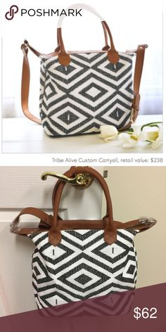 Tribe Alive Custom Carryall NWT Tribe Alive uses fashion as a platform to help alleviate poverty among women around the world. This bag is the hero piece in the Rachel Zoe spring box of style. Handmade leather and sharp black and white pattern weave a fresh warm weather carry for you! Tribe Alive Bags Crossbody Bags