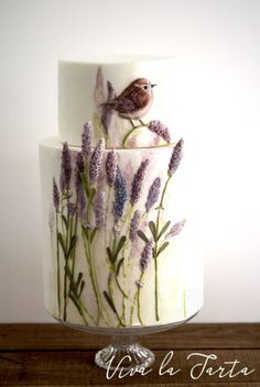 Two tiers fondant cake whit lovely lavender branchs and tiny robin. Bassrelief and color. Hope you like it!