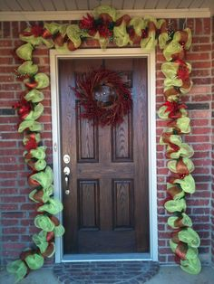 Finally finished my Christmas mesh garland for the front door! Lovin' it!