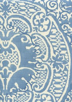 Quadrille Fabrics on oversized pillows with blue cord
