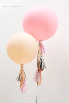 "My super talented friend Teissia of Firefly Events has been in town for the  last few weeks planning weddings for her clients. When she told me she had  to make some fringe balloons for an upcoming engagement shoot, I jumped at  the chance to photograph her process so I could share it with you. Please  enjoy!  WHAT YOU'LL NEED:      * 30""-36"" Round Balloons {get the balloons blown up at your local party       store, just make sure they can fit in your car}     * Tissue Paper &/orFabric in…"