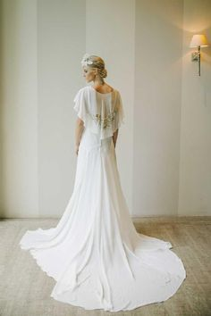 This beautiful boho beauty from Bouret has such a stunning detachable cape.    Available at Rock The Frock.