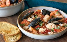 This is a simplified version of the classic and comforting Italian-American seafood stew that is often served during the holidays. The tomato base can be made ahead of time and refrigerated for up to 2 days or frozen for up to 3 months. When ready to serve, simply thaw, bring to a boil and add the seafood.