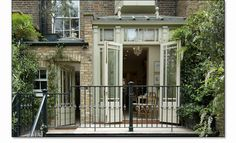 "Gorgeous little urban ""orangery""... a conservatory with a flat roof and a raised glass section in the centre."