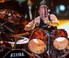 Lars Ulrich... TAMA STAR CLASSIC MAPLE DRUMS - Finish is LU Magnetic Orange (has been known to mix kits). Lars uses signature AHead drumsticks.