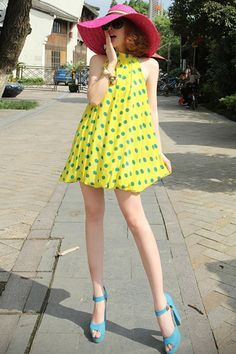 Dress made of chiffon, featuring standing collar, sleeveless styling, polka dot to main, zipped closure to back, A-line design, in mini length cut.$65