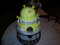 Adorable cake for Classic Winnie the Pooh baby shower