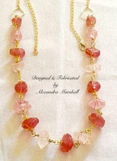 """""""Resin Rose"""" Pale, Light and Medium rose pink hand cast nuggets enveloped in gold wire wrapping are found in this necklace by Alexandra Marshall. Lobster clasp and chain straps facilitate adjustment from 26"""" to 31"""". $69. #N1001. Double click photo to visit my web store."""