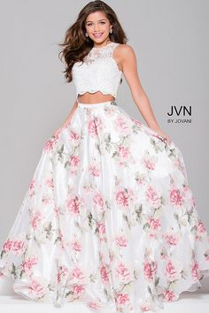 Beautiful floor length two piece prom ballgown features sleeveless white lace crop top with embellishments and a multi color skirt.