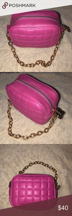 BCBGMaxAzria hot pink mini handbag BCBGMaxAzria mini handbag in HOT PINK!  Gold hardware.  Just another item of abundance in the life of my closet!  Very spacious inside for phone, keys, lipsticks credit cards, glasses and maybe even more!  Never used- smoke free home. Perfect condition-   See the never used purpley color too!  Bundle together for a special savings! BCBGMaxAzria Bags Mini Bags