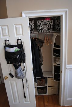 Small entry closet makeover I SAY. to dark as far as colors, but workable in design for the little closet :)