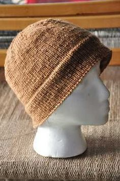 """A very easy pattern that knits up quickly.    The Monmouth Cap has been around since the 1600's and was, at one time, required gear for infantry in the 18th century.     I've made this cap in a lovely shade of red which my father then stole from me. He now wears it all the time, mostly under his motorcycle helmet, and calls it """"his sailor cap."""""""
