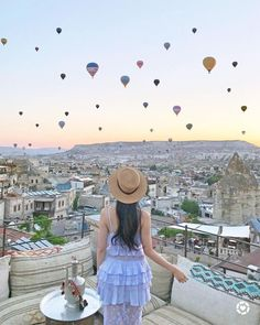 @ofleatherandlace Instagram | Hot air balloons at Sultan Cave Suites of Goreme, Cappadocia, Turkey