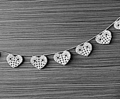 Wedding garland, crocheted hearts decorations, white lace ornaments. $35.00, via Etsy.