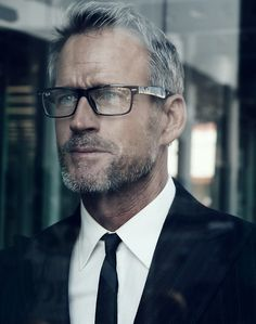 Mark Ray - love the details. The glasses, the suit, the tie, the silver fox stubble. Nice.