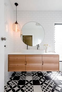 Round mirrors can fine tune the design of the bathroom to a more contemporary, eclectic, modern, country or chic style depending on their design and material. A matching lighting fixture, like a sconce next to it or right above or a mini pendant that is hung off-centered, completes the look while bringing depth and function.