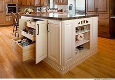Cabinets: A painted island adds a bright touch in this Showplace red oak kitchen Build Kitchen Island, Oak Kitchen Cabinets, Kitchen Sink Storage, Kitchen Storage Solutions, Interior Design For Beginners, Kitchen Exhaust, Ikea, Cocina Diy, Two Tone Kitchen
