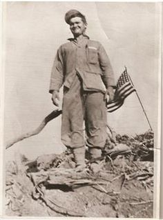 IWO JIMA-Private First Class Jack Thurman on Iwo Jima, Feb. 23, 1945. Thurman was 19 years old when he landed on the island with the 5th Marine Division. Thurman was honorably discharged as a sergeant after the war and now lives in Longmont, Colo., Photo Courtesy of Jack Thurman, 2/23/1945   A crowd of 222 Marines and family listened as Jack Thurman gave his account of landing on Iwo Jima in 1945, standing on top of Mt. Suribachi with Ira Hayes and being in a famous photo taken by Joe…