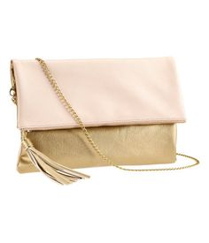 Imitation leather bag with tassel and detachable metal shoulder strap. Zip and magnetic closure and inner pocket with zip. Lined. Bag $17.95