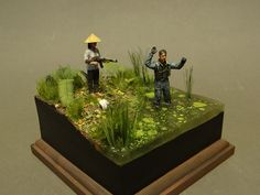 Vietnamese girl figure by MB and resin figure of pilot on the self-made base. Acrylic paints.