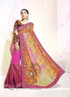This multi colour georgette and silk designer saree is adding the desirable glamorous displaying the feel of cute and graceful. The appealing patch border and print work all through the dress is awe i...