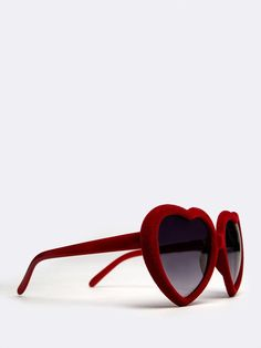 - Put your style a cut above the rest and get noticed in these heart shaped sunglasses. - Shades are made of soft velvet frames and has a dark, gradient lens. - Color- Red - Final Sale.