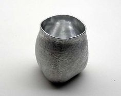 """""""Sake cup"""" by Seikado. It is made by hitting a relatively thin sheet of pewter using hammers and wooden mallets, and choosing to stretch or raise the metal depending on the section. The rough surface is a texture called """"Ishime""""(meaning stone pattern), which is created in a traditional method using a hammer."""