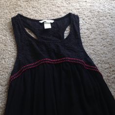 H&M tank Black Flowy tank from H&M with pattern top and red stitch detail. Size US 6, I would say could fit either small or medium (size 3 or 4). Only worn twice, like new! H&M Tops Tank Tops