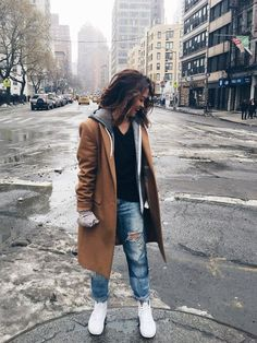 You know you'll be warm in this outfit. The long coat is great for a snowy day and the white sneakers add a little street style to the look!