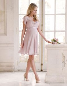 Expertly cut, our Blush Silk Chiffon Maternity Dress is a true investment in style. Fully lined; the luxurious silk drapes elegantly to finish above the knee, providing a flexible fit for before, during and after pregnancy. Secure the detachable silk sash in a bow at the back to define your empire waist and flatter your changing figure. A soft cowl neckline and feminine flutter sleeves provide the perfect finishing touches to the style, making it the perfect choice for bridesmaids or for any…