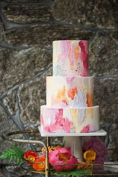 Pink and orange painterly wedding cake with black dots