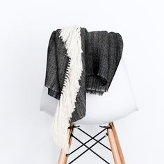 Inspired by cold, dark nights in the Andres, this throw is a modern take on traditional Peruvian patterns. The rich, graphic weave adds a cozy touch to any bedroom or living space.