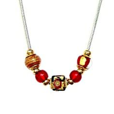 Italian Glass Bead Necklace, Bracelet and Earrings!  Each is handmade with authentic Italian Glass Beads.  We love the vibrant colors layered in sparkling Murano Glass with shimmering gold and silver foil.  We are starting our collection with this beautiful set in deep red.