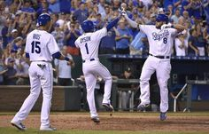 Kansas City Royals' Mike Moustakas (8) is congratulated by Jarrod Dyson (1) and Alex Rios (15) after Moustakas hit a three run home run in the seventh inning during Wednesday's baseball game against the Pittsburgh Pirates on July 22, 2015 at Kauffman Stadium in Kansas City, MO.