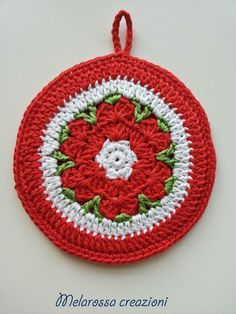 Circular kitchen pot holder with crochet flower pattern made of cotton. Accessory kitchen, decorating, gift idea
