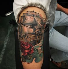 New School Tatoo Of Pirantes Ship And Red Flower Rose Tattoo At Arm Hand Tattoo Design