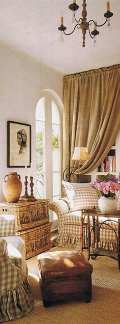 Love the drapes in front of the book cases...
