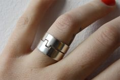 sterling silver love puzzles ring.