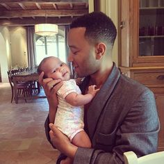 So Cute!: John Legend Shares an Adorable Photo of Himself Holding Baby Daughter Luna — See the Pic!