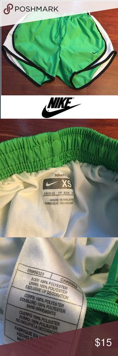 Nike Women's Green Running Shorts Nike Women's Green Running Shorts. White and black trim. Built in underwear. Worn just a couple of times. Excellent condition. 3.5 inch inseam. 10.5 inch rise. Elastic waist with drawstring. Feel free to make an offer or bundle & save! Nike Shorts